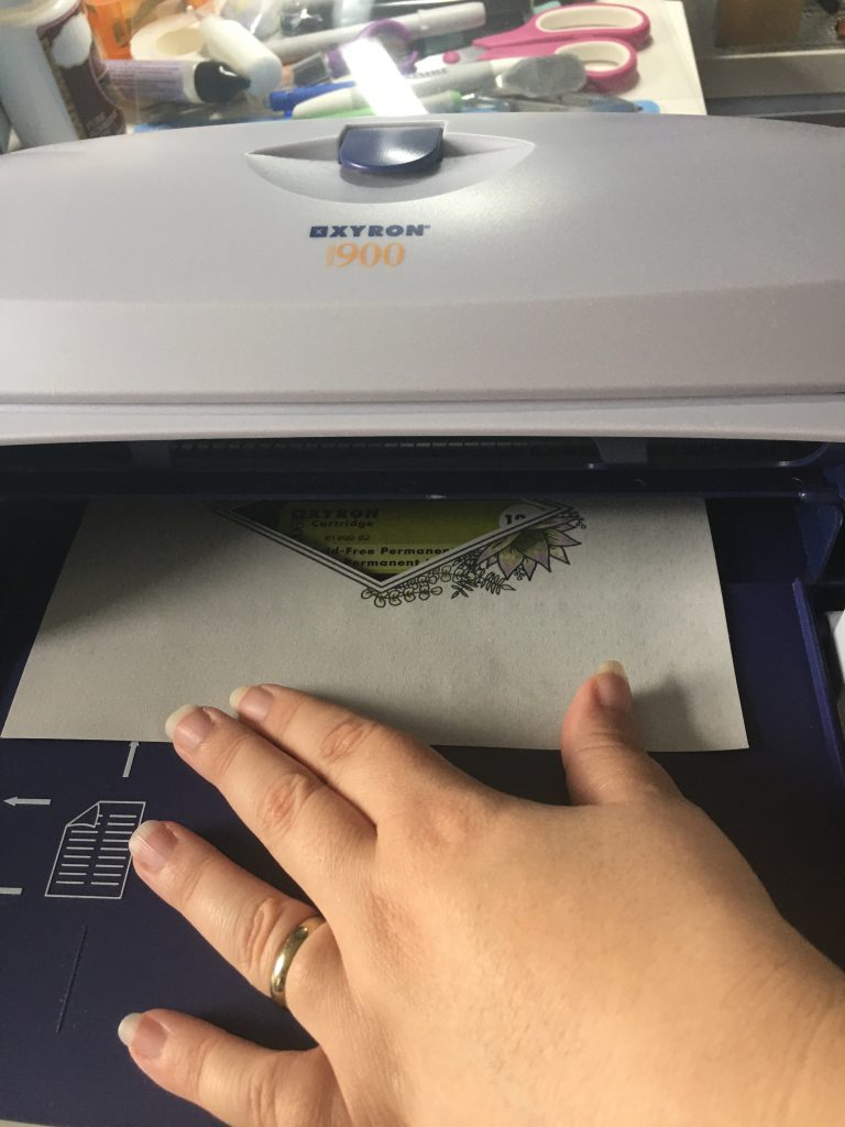 Applying Adhesive with a Xyron Machine